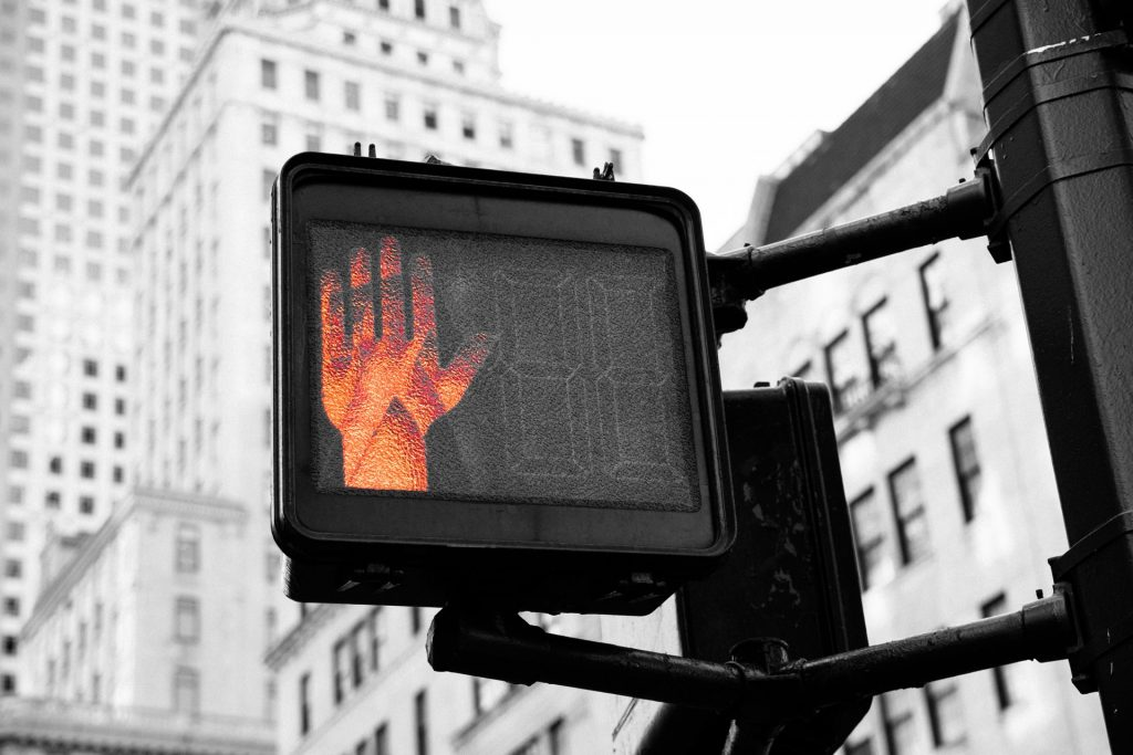 Crossing signal with red hand illuminated