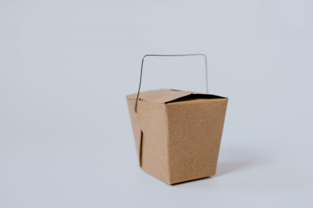 Brown takeout box with wire handle